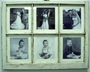 Family photos in antique window sash