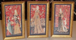 Three postcards framed separate & joined to stand on table